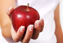 apple hand woman
